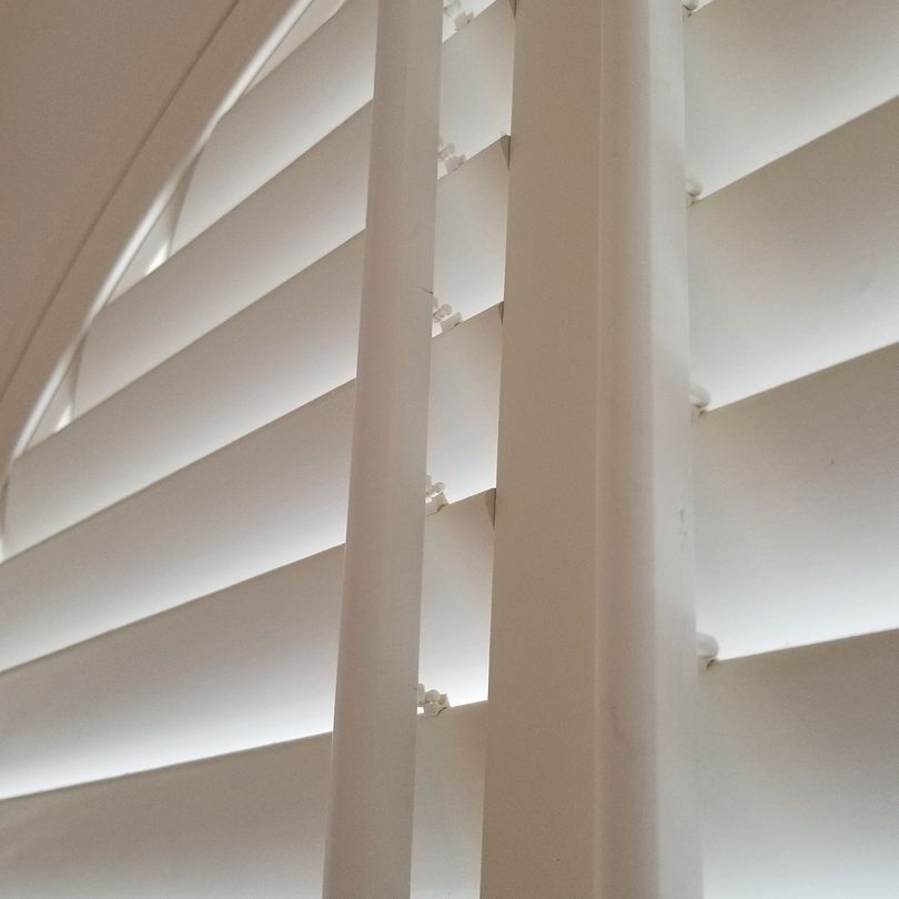 Sunburst Shutters, Arch Shutters, Shutters, Hunter Douglas Shutters, Palm Beach Shutters, S.P. Interiors, Framed Shutters, Split View Shutters, Divider Bar, Shutter Installation